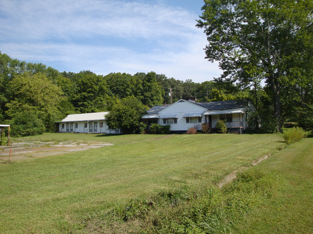 SOLD – Absolute Auction of Duplex on 1.5 Acres